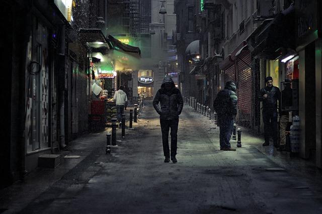 stranger walks in the dark street
